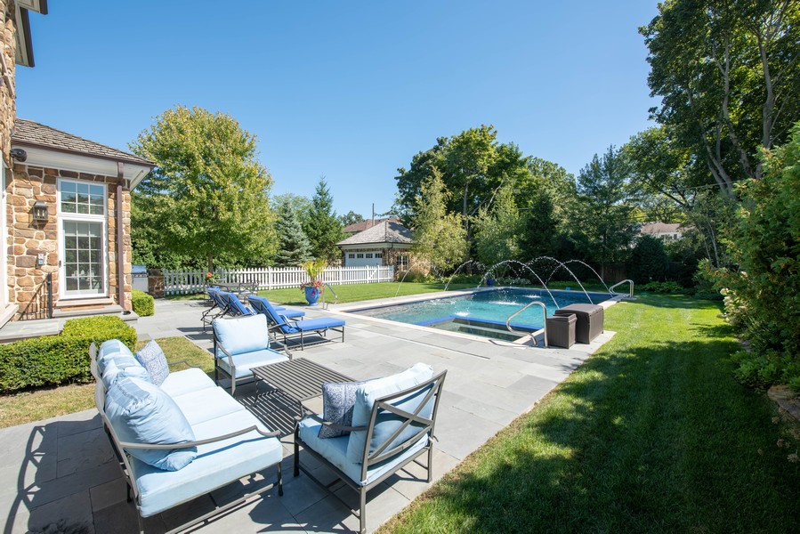 Real Estate Photography - 174 Beach Road, Glencoe, IL, 60022 - Lounging Patio and Pool