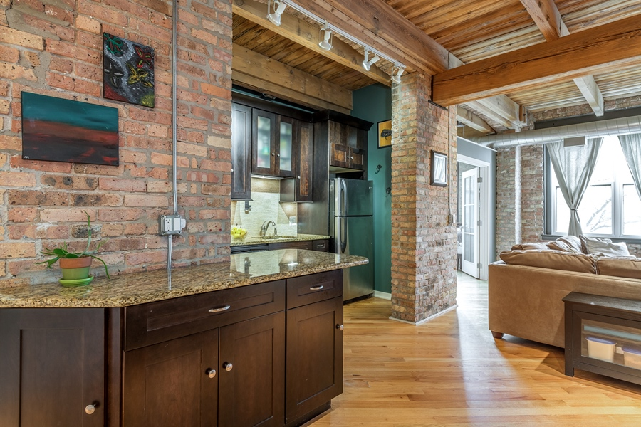 Real Estate Photography - 3201 N Ravenwood, Unit 211, Chicago, IL, 60657 - Kitchen / Living Room