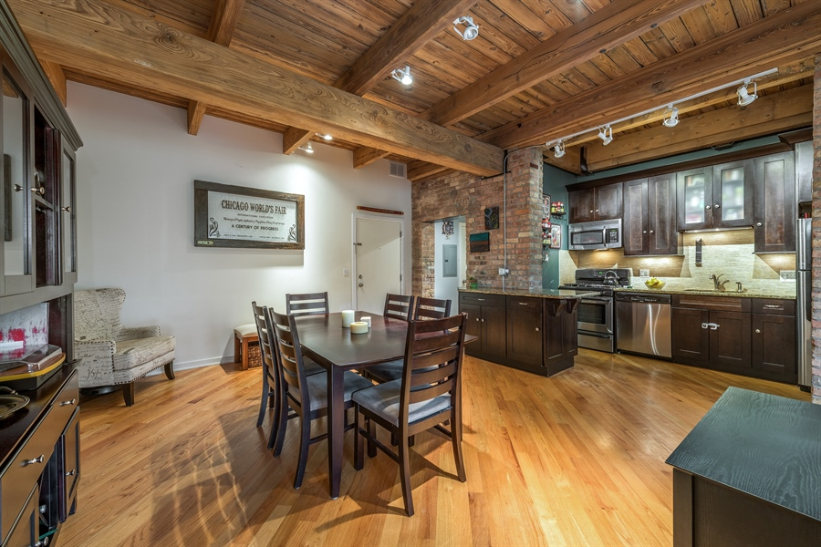 Real Estate Photography - 3201 N Ravenwood, Unit 211, Chicago, IL, 60657 - Kitchen / Dining Room