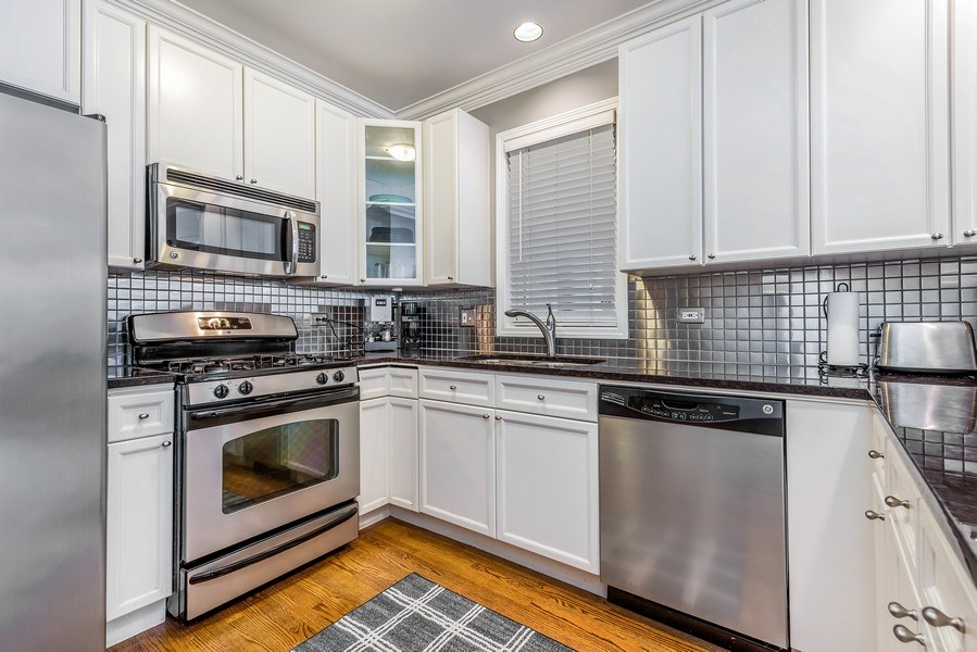 Real Estate Photography - 2139 W Addison St, Unit 1, Chicago, IL, 60618 - Kitchen