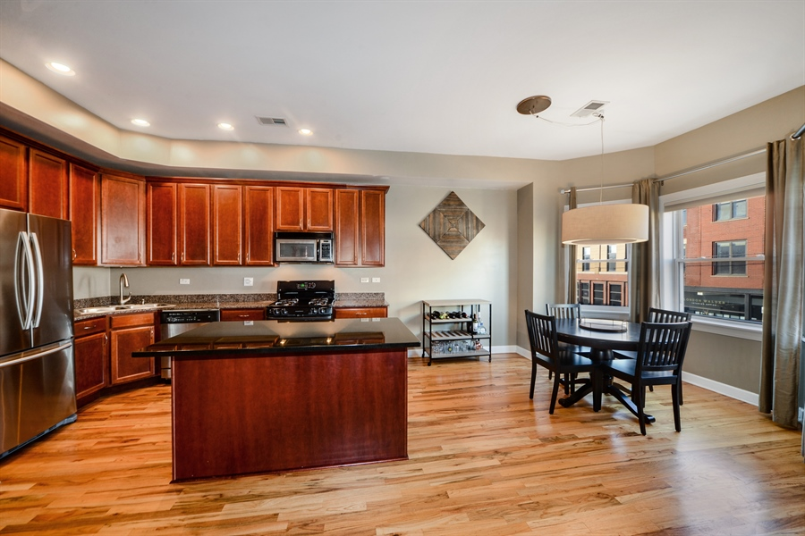 Real Estate Photography - 1813 W. Grand, 2, Chicago, IL, 60622 - Living Room / Dining Room