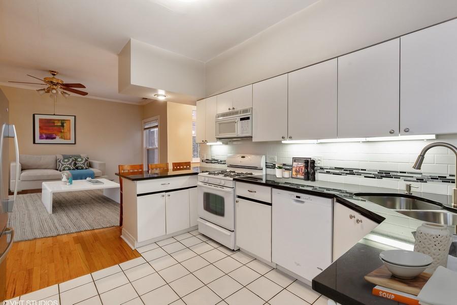 Real Estate Photography - 652 Aldine, #2, Chicago, IL, 60657 - Kitchen Toward Living Room