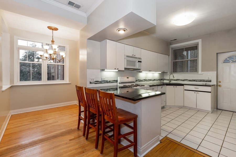 Real Estate Photography - 652 Aldine, #2, Chicago, IL, 60657 - Kitchen / Dining Room