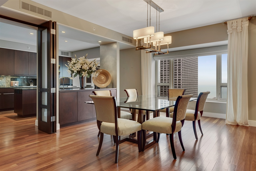 Real Estate Photography - 800 N Michigan Ave, Unit 4801, Chicago, IL, 60611 - Dining Room