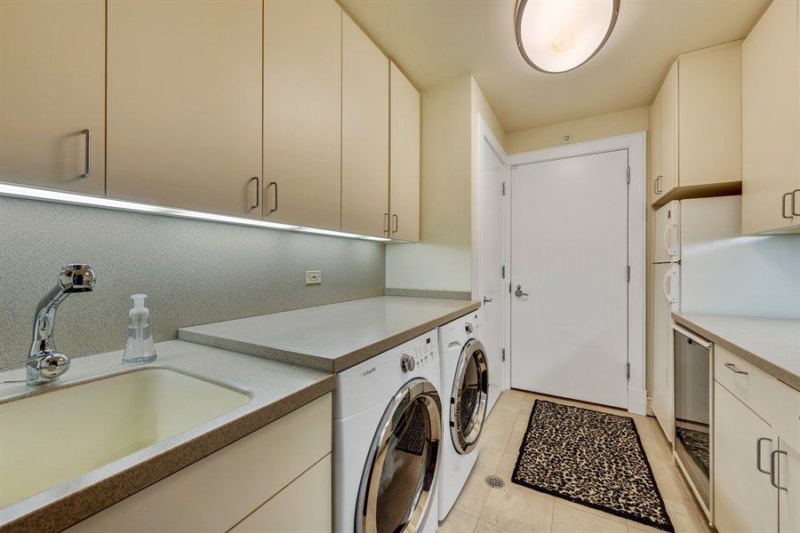 Real Estate Photography - 800 N Michigan Ave, Unit 4801, Chicago, IL, 60611 - Laundry Room