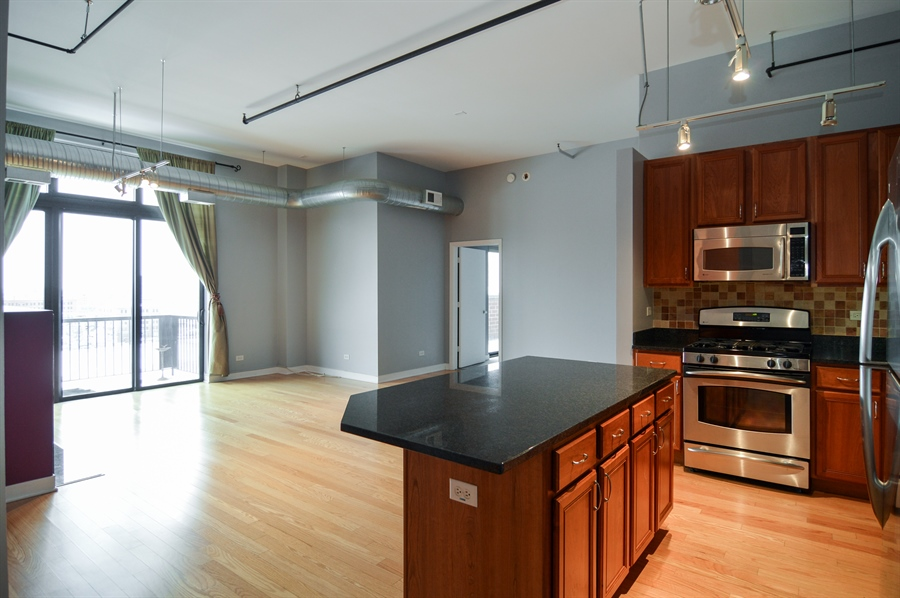 Real Estate Photography - 833 W 15th Pl, Unit 907, Chicago, IL, 60608 - Kitchen / Living Room