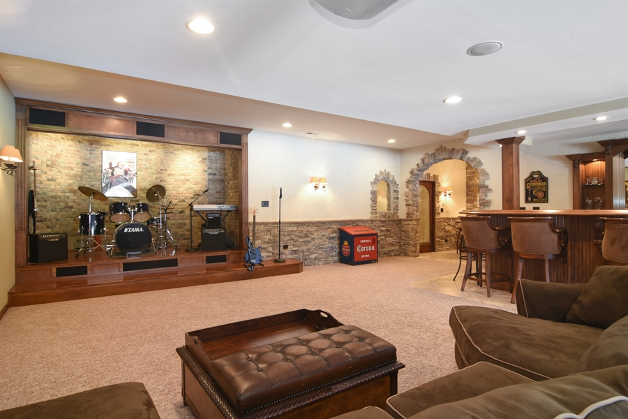 Real Estate Photography - 580 W Ruhl, Palatine, IL, 60074 - Theater Room with Stage Looking into Bar