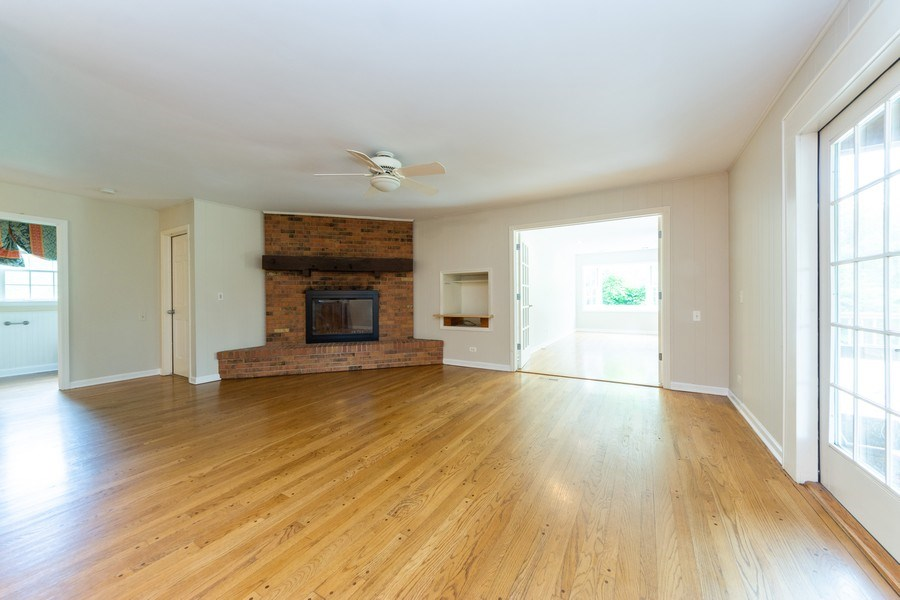 Real Estate Photography - 25877 Apache, Lake Barrington, IL, 60010 - Family room w fireplace opening to screened porch,