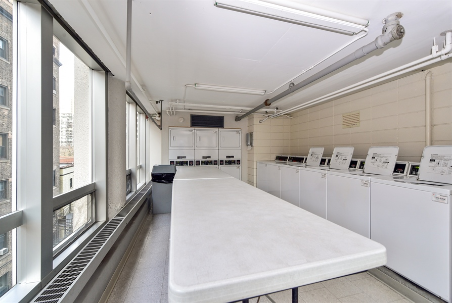 Real Estate Photography - 1300 N Astor St, Unit 16C, Chicago, IL, 60610 - Laundry Room