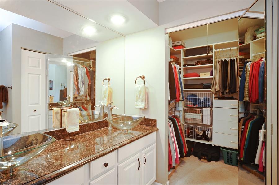 Real Estate Photography - 1520 Loatonia Ct, Libertyville, IL, 60048 - Master Bedroom Closet