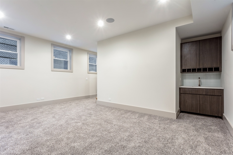 Real Estate Photography - 1213 E. 46th Street, 1, Chicago, IL, 60653 - Lower Level | Family Room | Bar