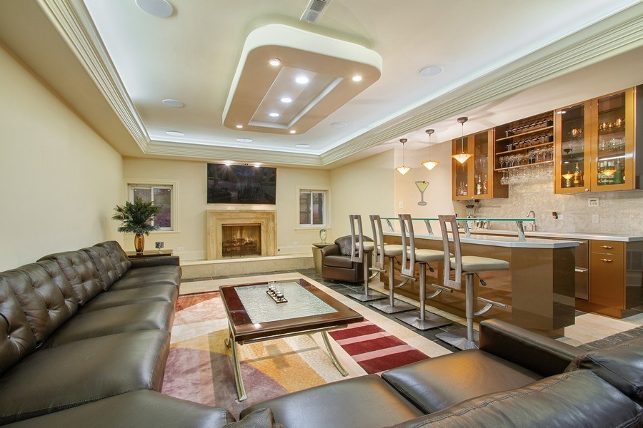 Real Estate Photography - 6455 N Sauganash Ave, Lincolnwood, IL, 60712 - Lower Level Wet Bar