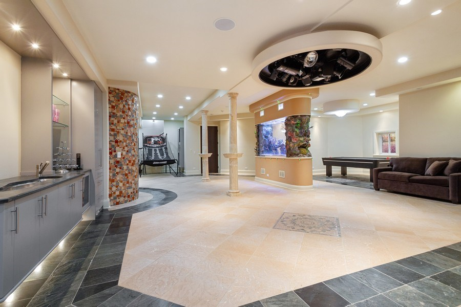 Real Estate Photography - 6455 N Sauganash Ave, Lincolnwood, IL, 60712 - Lower Level Giant Rec Room