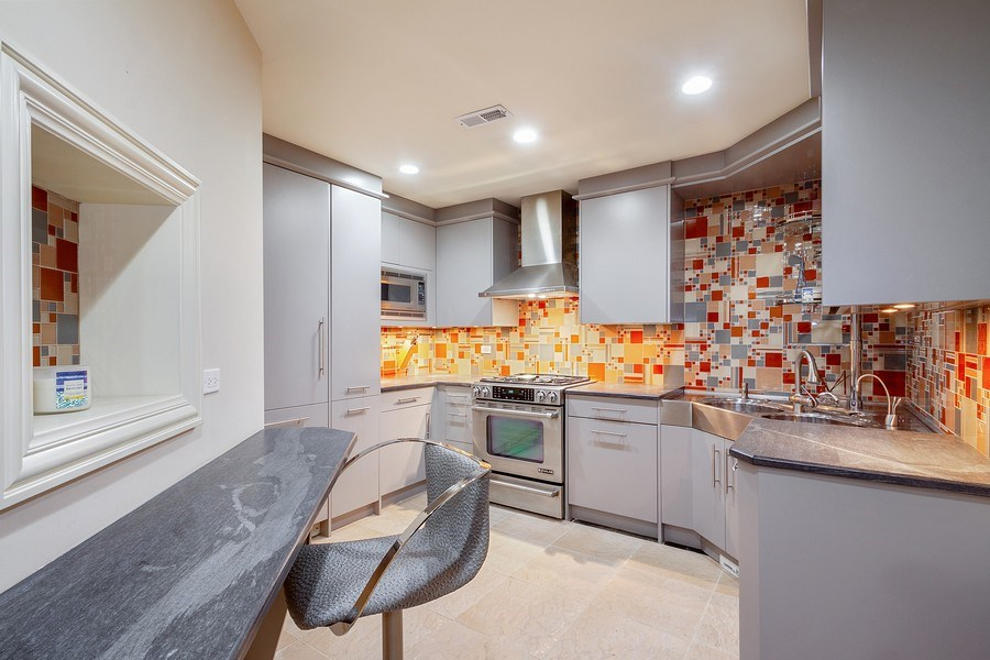Real Estate Photography - 6455 N Sauganash Ave, Lincolnwood, IL, 60712 - Lower Level 2nd Full Kitchen