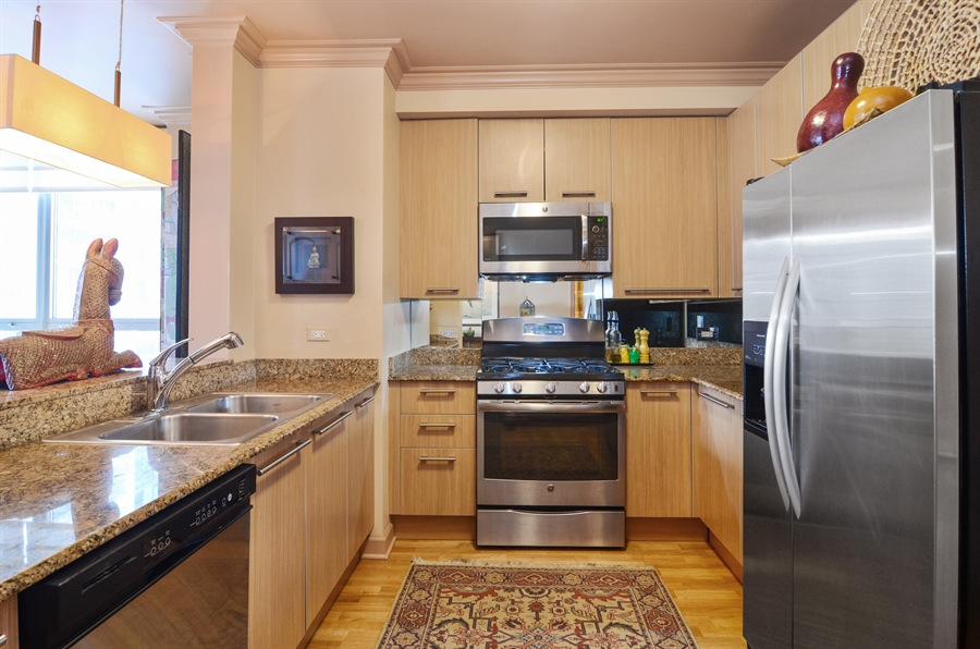 Real Estate Photography - 420 E Waterside Drive, 2403, Chicago, IL, 60601 - Kitchen with upgraded appliance & cabinets