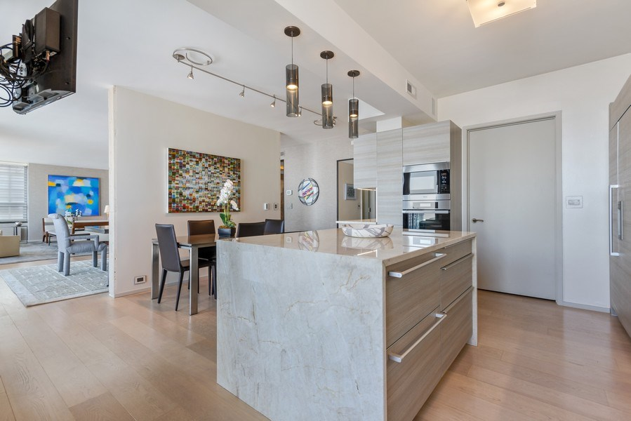 Real Estate Photography - 1040 Lake Shore Dr, Unit 15A, Chicago, IL, 60611 - Kitchen Center Island /Entrance to Laundry