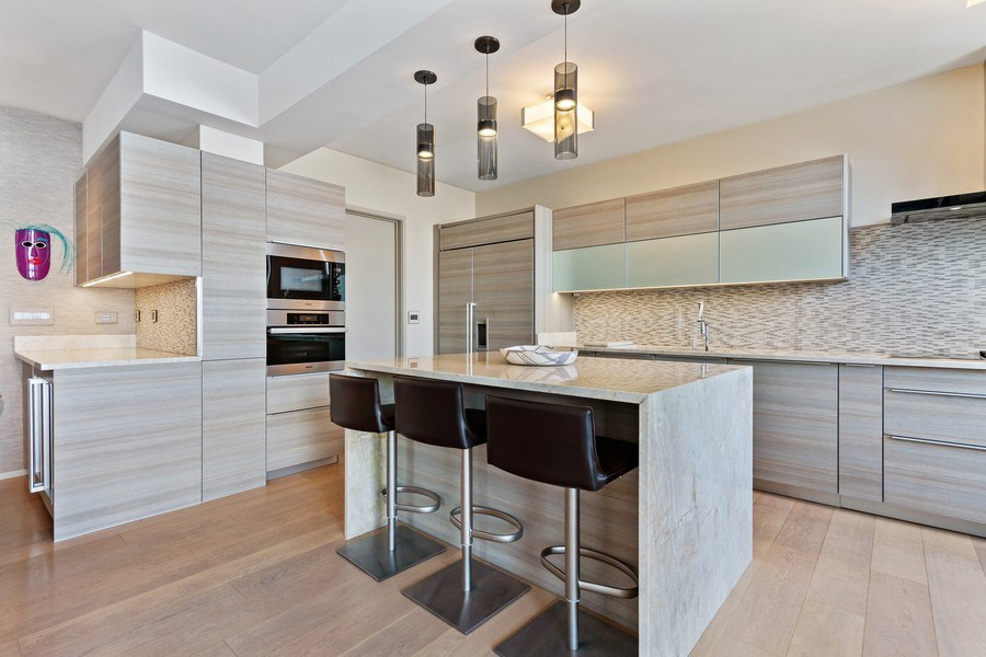 Real Estate Photography - 1040 Lake Shore Dr, Unit 15A, Chicago, IL, 60611 - Kitchen Breakfast Bar & Pantry