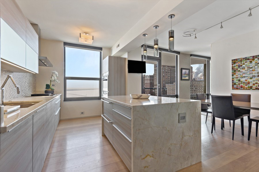 Real Estate Photography - 1040 Lake Shore Dr, Unit 15A, Chicago, IL, 60611 - Eat in Kitchen / Center Island