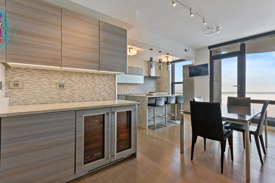 Real Estate Photography - 1040 Lake Shore Dr, Unit 15A, Chicago, IL, 60611 - Buttlers Pantry/ Wine Cooler / Kitchen Dining