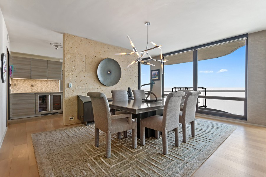 Real Estate Photography - 1040 Lake Shore Dr, Unit 15A, Chicago, IL, 60611 - Dining Room With East Views