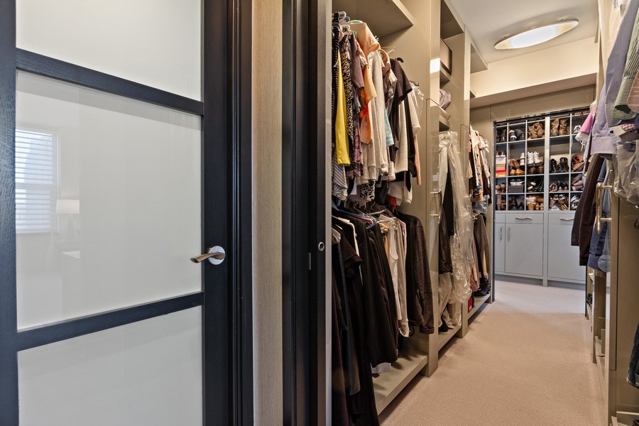 Real Estate Photography - 1040 Lake Shore Dr, Unit 15A, Chicago, IL, 60611 - Master Bedroom Closet