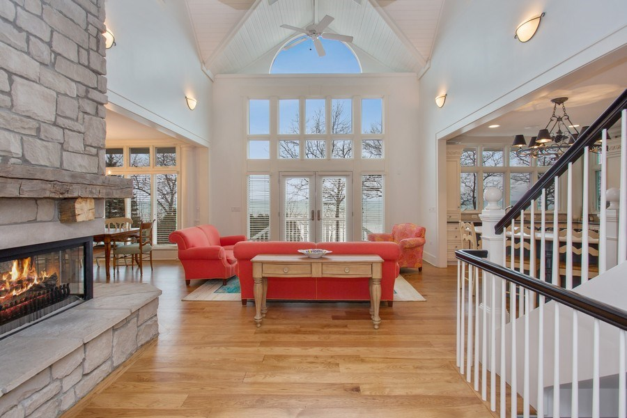 Real Estate Photography - 13173 Sunset Point, New Buffalo, MI, 49117 - Living Rm 2 Story Wall of Windows with Lake View