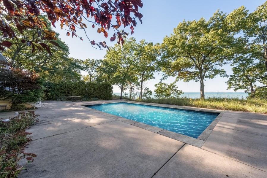 Real Estate Photography - 13173 Sunset Point, New Buffalo, MI, 49117 - Pool Area With Lake View