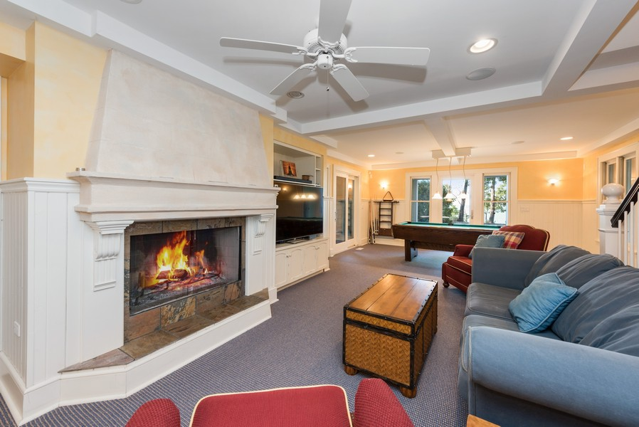 Real Estate Photography - 13173 Sunset Point, New Buffalo, MI, 49117 - LL Rec Room with Fireplace Opens to Pool