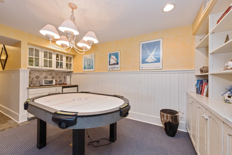 Real Estate Photography - 13173 Sunset Point, New Buffalo, MI, 49117 - LL Game Area with Wet Bar & Custom Cabinetry