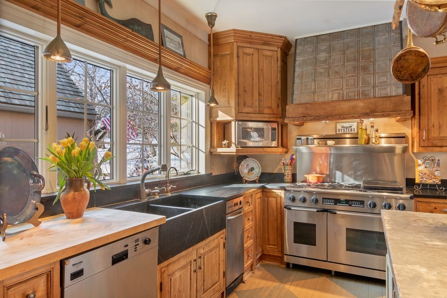 Real Estate Photography - 25130 N Cayuga Trail, Lake Barrington, IL, 60010 - Custom Tin Hood over Dacor Range & Soapstone Farm