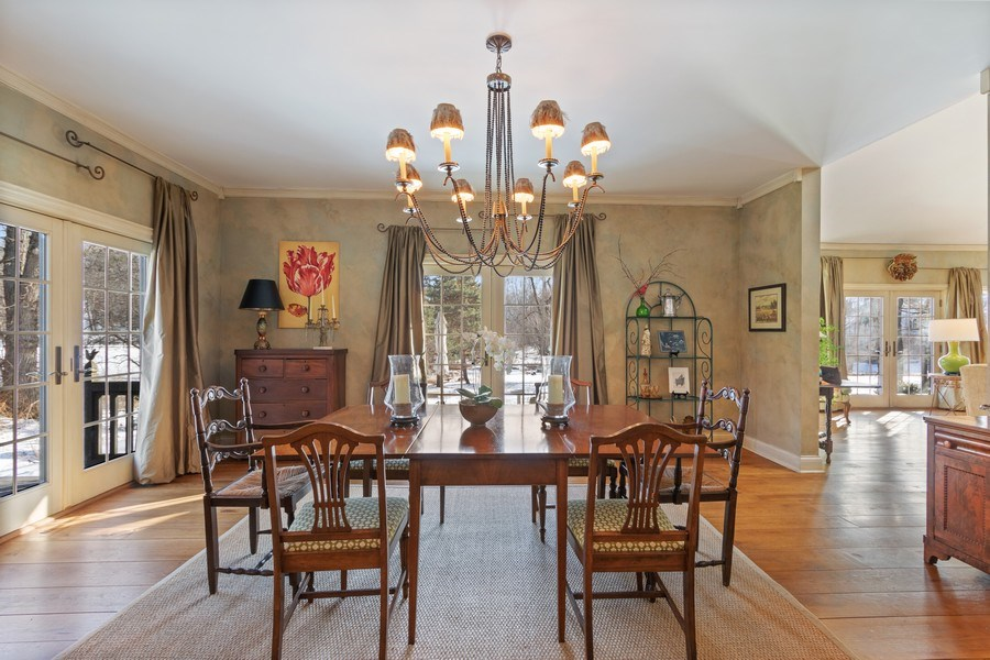 Real Estate Photography - 25130 N Cayuga Trail, Lake Barrington, IL, 60010 - Dine Under Antique Chandelier with Pond Views