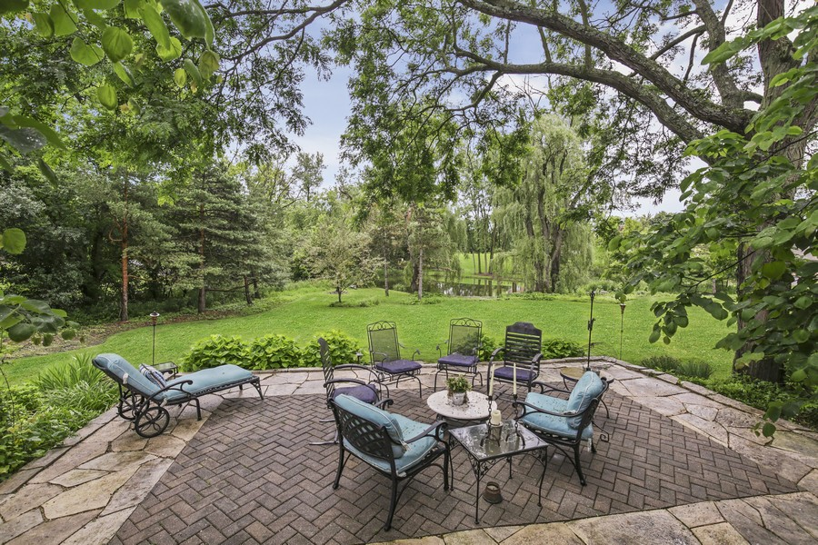 Real Estate Photography - 25130 N Cayuga Trail, Lake Barrington, IL, 60010 - Stone Paver Patio with Pond View