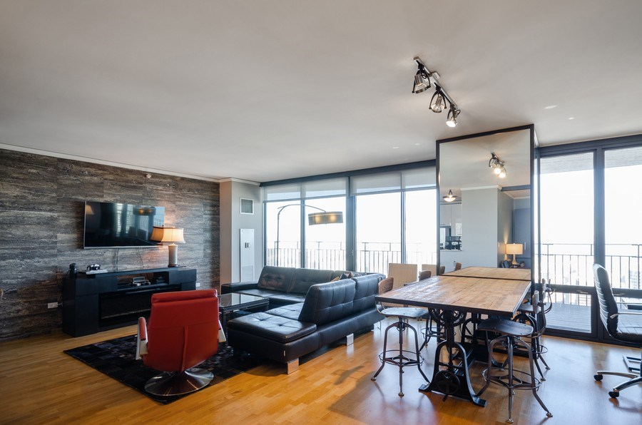 Real Estate Photography - 225 N Columbus, Unit 5804, Chicago, IL, 60601 - Living Room / Dining Room