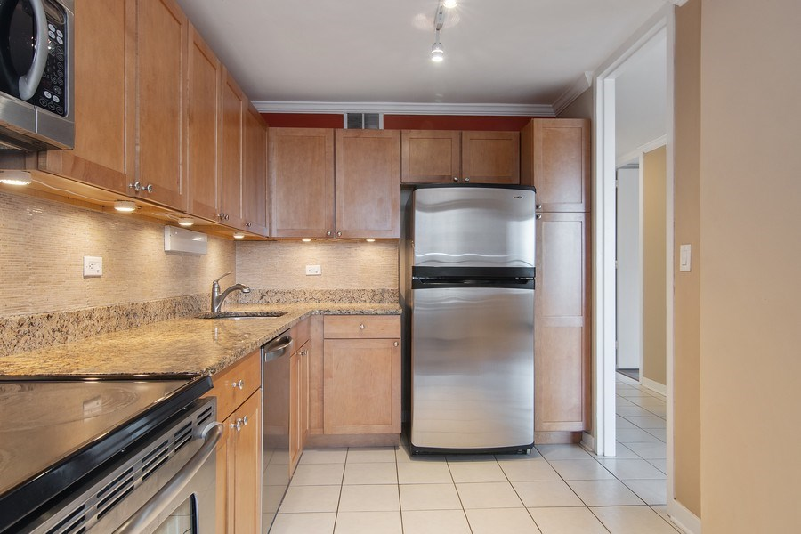 Real Estate Photography - 655 W Irving Park Rd, Unit 910, Chicago, IL, 60613 - Kitchen