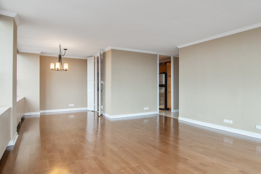 Real Estate Photography - 655 W Irving Park Rd, Unit 910, Chicago, IL, 60613 - Living Room/Dining Room
