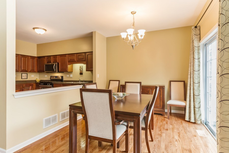 Real Estate Photography - 1979 Fountain Grass Circle, Bartlett, IL, 60103 - Dining Room