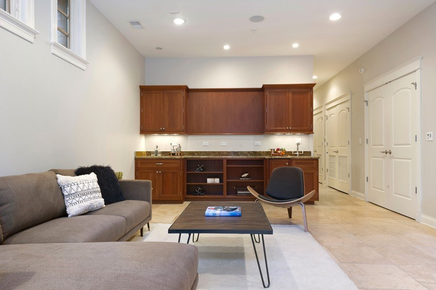 Real Estate Photography - 2309 N. Janssen Ave., Chicago, IL, 60614 - Lower Level Family Room with Bar - High Ceilings