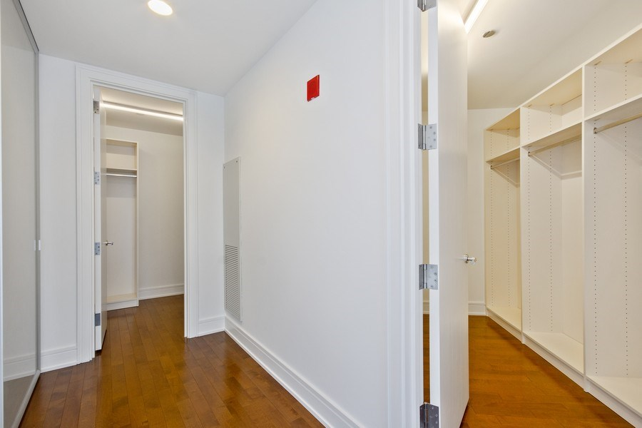 Real Estate Photography - 401 N Wabash, Unit 69G, Chicago, IL, 60611 - Master Bedroom Closet