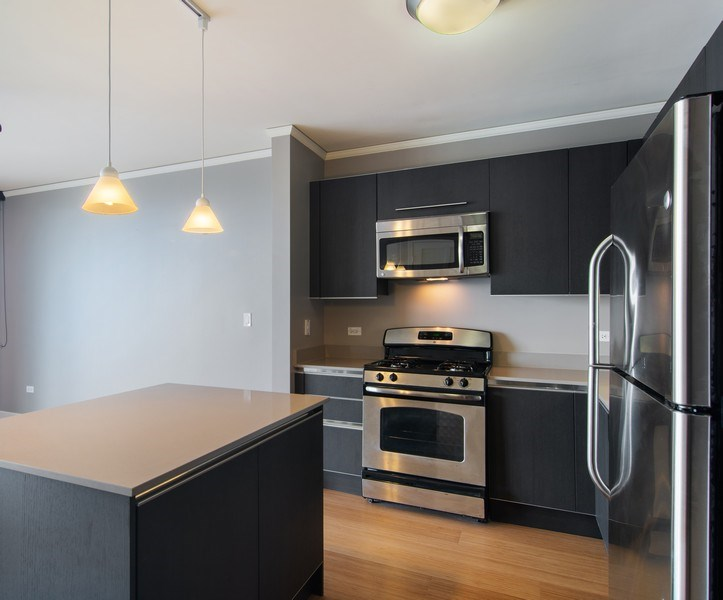 Real Estate Photography - 225 N Colombus, Unit 5406, Chicago, IL, 60601 - Kitchen / Living Room