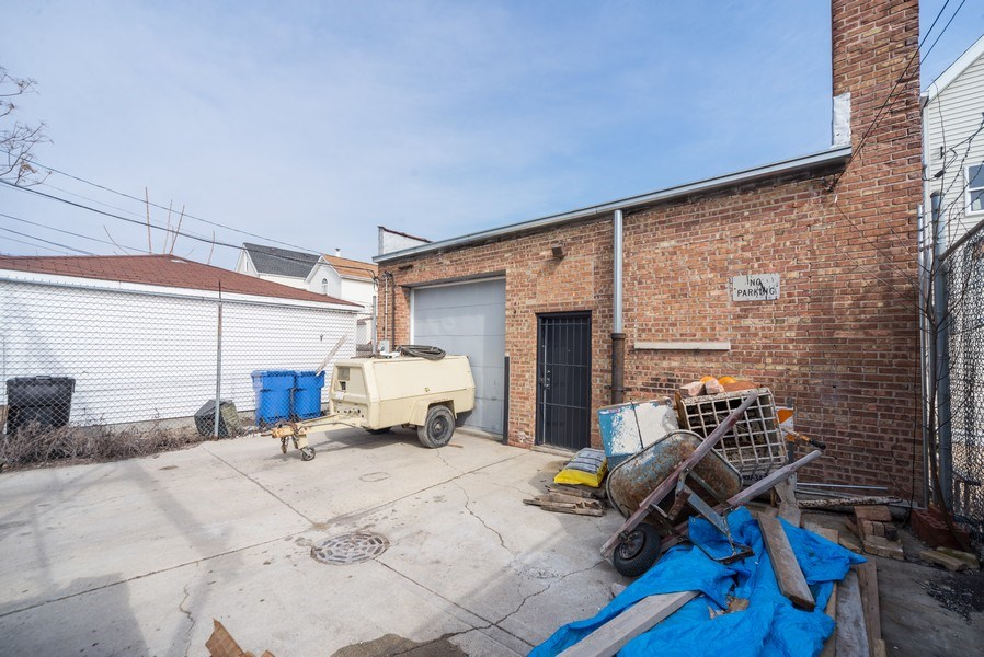 Real Estate Photography - 1714 N Pulaski Ave, Chicago, IL, 60639 - Rear View