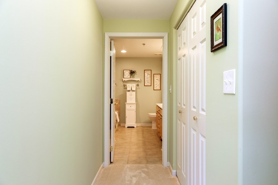 Real Estate Photography - 543 N Hough St, Unit 204, Barrington, IL, 60010 - Master Bedroom Walk-in Closet