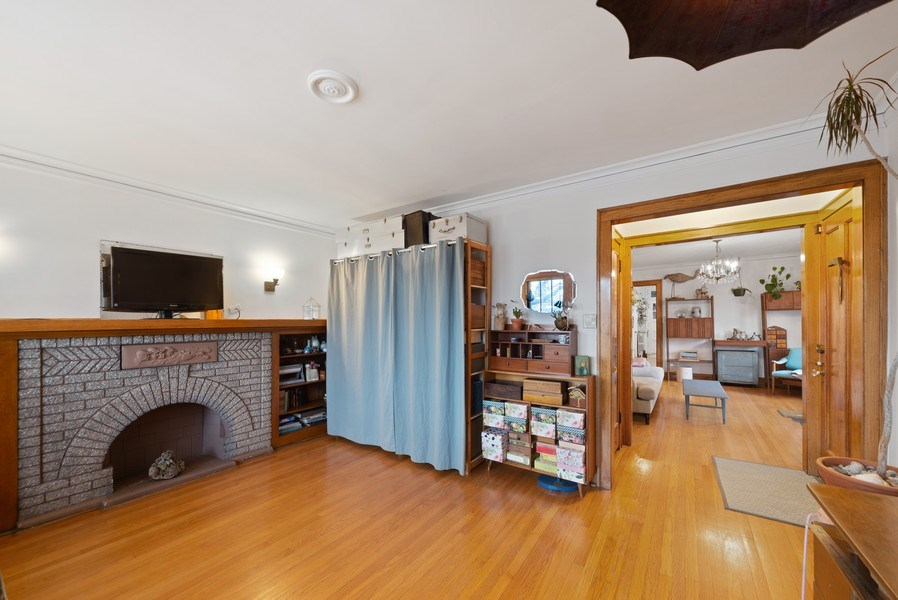 Real Estate Photography - 4042 N Springfield, Chicago, IL, 60618 - Unit 2 Living Room View 2