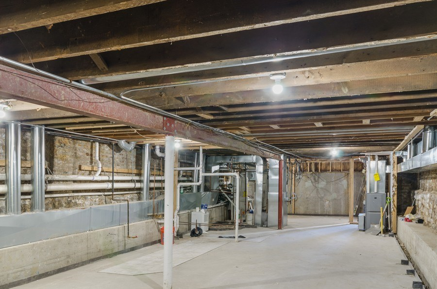 Real Estate Photography - 3642 S Union Ave, Chicago, IL, 60609 - Light & Bright Basement - 3rd Bathroom plumbing in