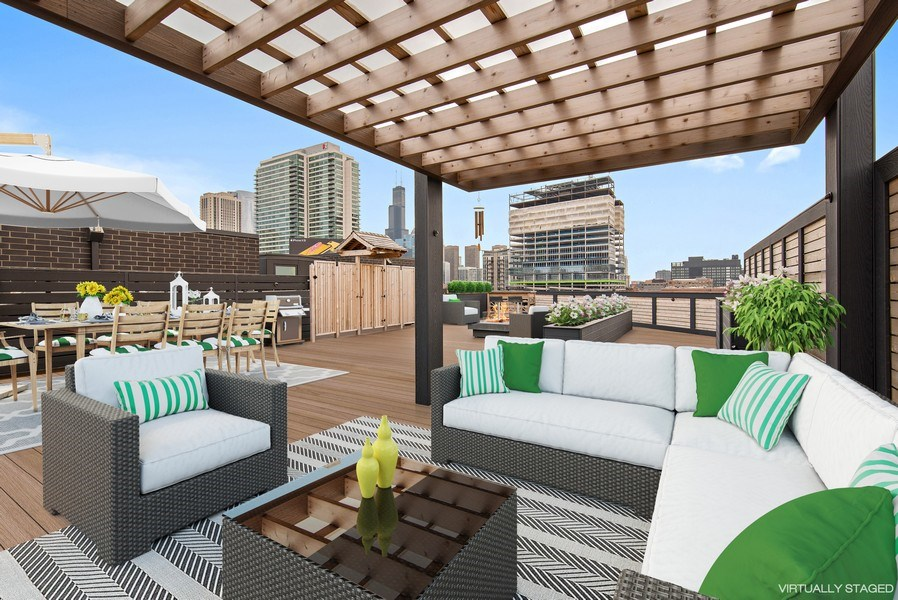 Real Estate Photography - 836 W Hubbard St, Unit 502, Chicago, IL, 60642 - Roof deck with gorgeous Chicago Skyline views!
