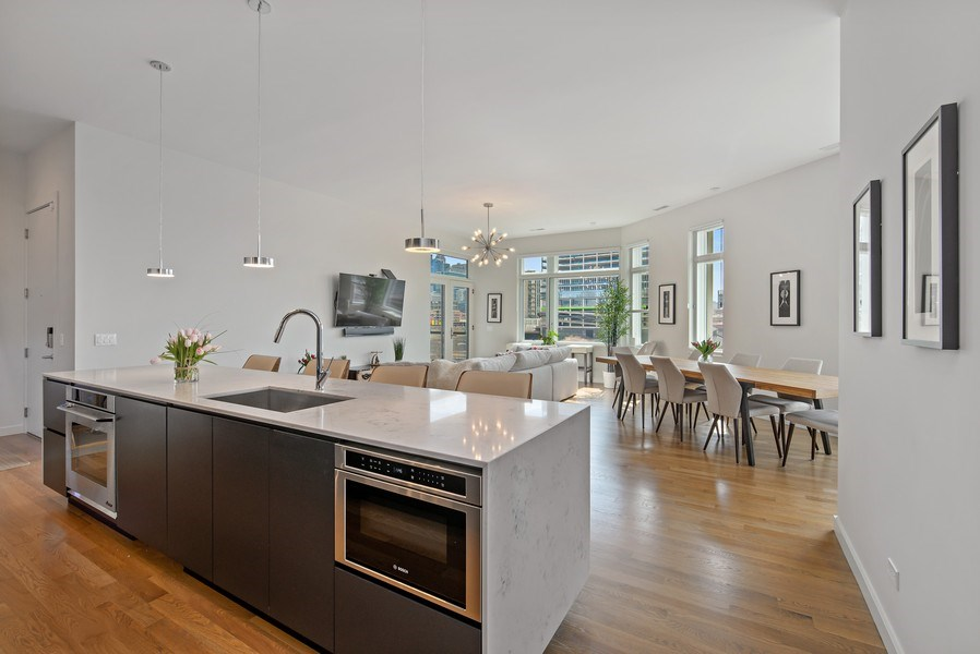 Real Estate Photography - 836 W Hubbard St, Unit 502, Chicago, IL, 60642 - Fabulous open floor plan kitchen/living/dining roo