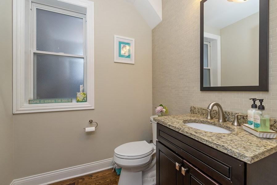 Real Estate Photography - 4825 N Ridgeway Ave, Chicago, IL, 60625 - 1st floor half bath