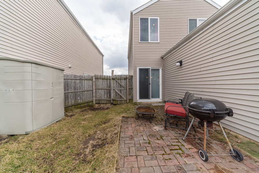 Real Estate Photography - 1756 Simms, Aurora, IL, 60504 - Backyard with Paver Patio