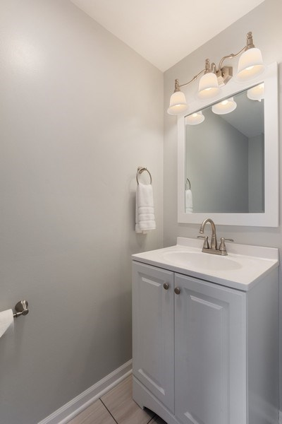 Real Estate Photography - 432 Meadow Hill Ln, Round Lake Beach, IL, 60073 - Powder Room