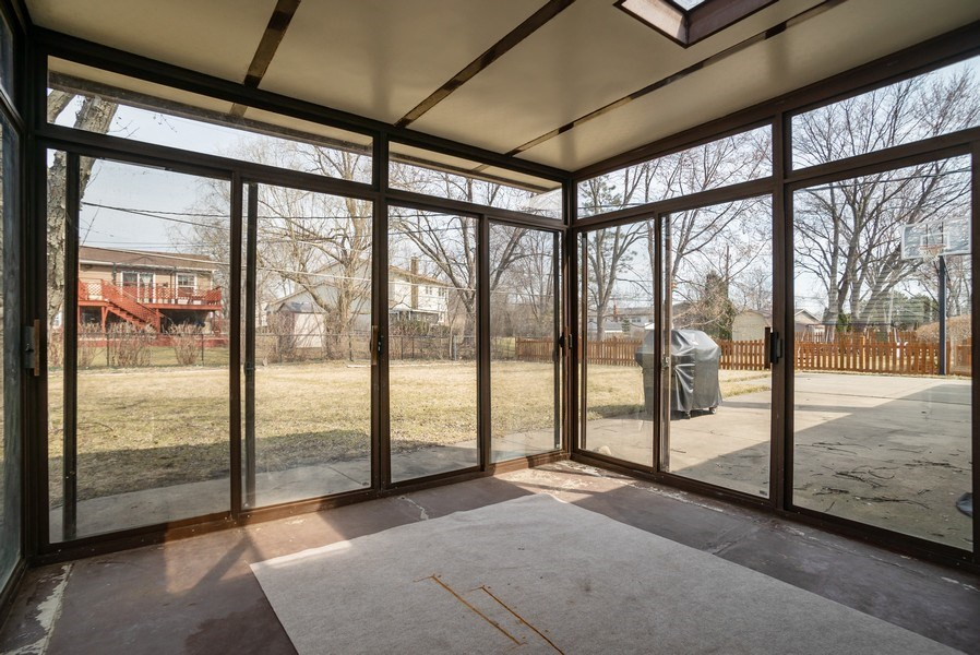 Real Estate Photography - 504 W. Brittany Drive, Arlington Heights, IL, 60004 - Sun Room | Concrete Patio | Perfect for Grilling