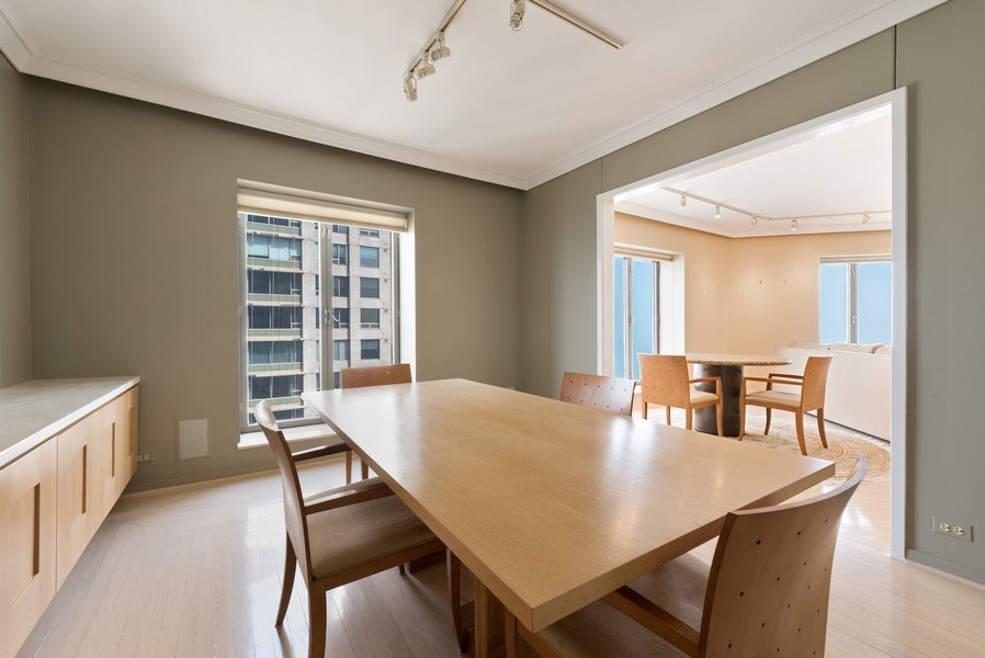 Real Estate Photography - 950 N Michigan Ave, Unit 4203, Chicago, IL, 60611 - Dining Room
